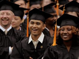 Students at graduation ceremony (© AP Images)