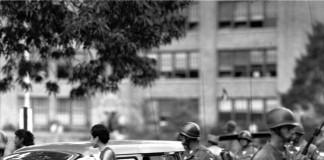 Soldiers escort the Little Rock Nine to school in Arkansas