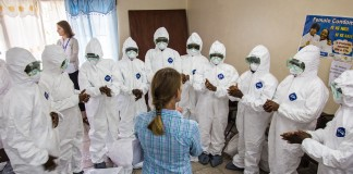 A World Health Organization worker trains Ebola health workers to use protective gear in Freetown, Sierra Leone.