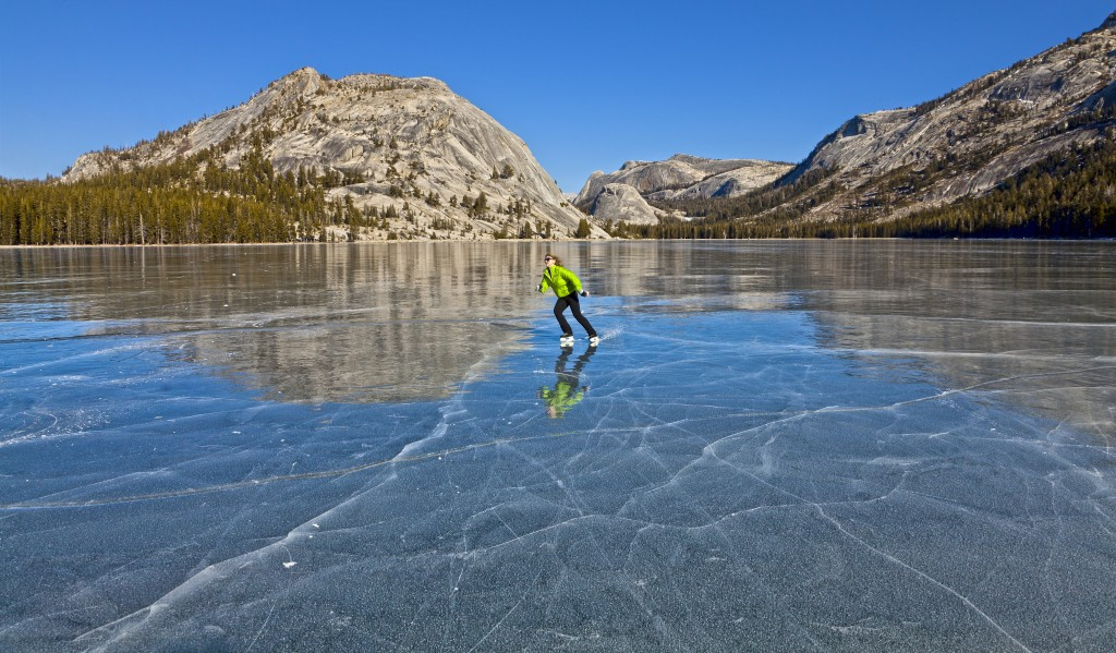 An ice skater skates across Tenaya Lake in Yosemite National Park