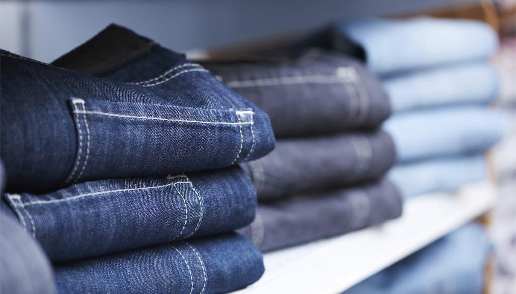 Piles of folded jeans on shelf (Thinkstock)