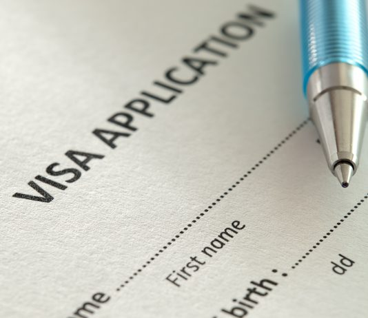 Pen resting on visa application paperwork (Thinkstock)