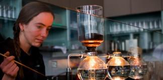 Woman with coffee in glass flasks (Matt Biddulph/Blue Bottle Cafe)