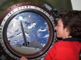 NASA astronaut Ellen Ochoa looking out window toward Earth (NASA)