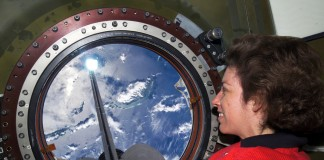 NASA astronaut Ellen Ochoa looking out window toward Earth (NASA)