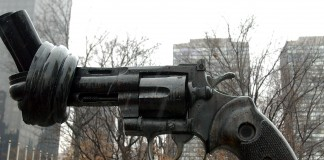 Sculpture of gun with barrel tied in knot (AP Images)