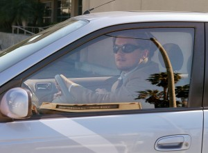 Leonardo DiCaprio driving hybrid car to fight climate change (AP Images)