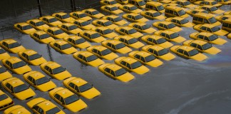 Taxis in flooded parking lot (AP Images)