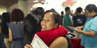 Salve Reed hugging friend (© AP Images)