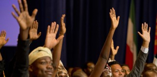 People raising their hands to ask question (AP Images)
