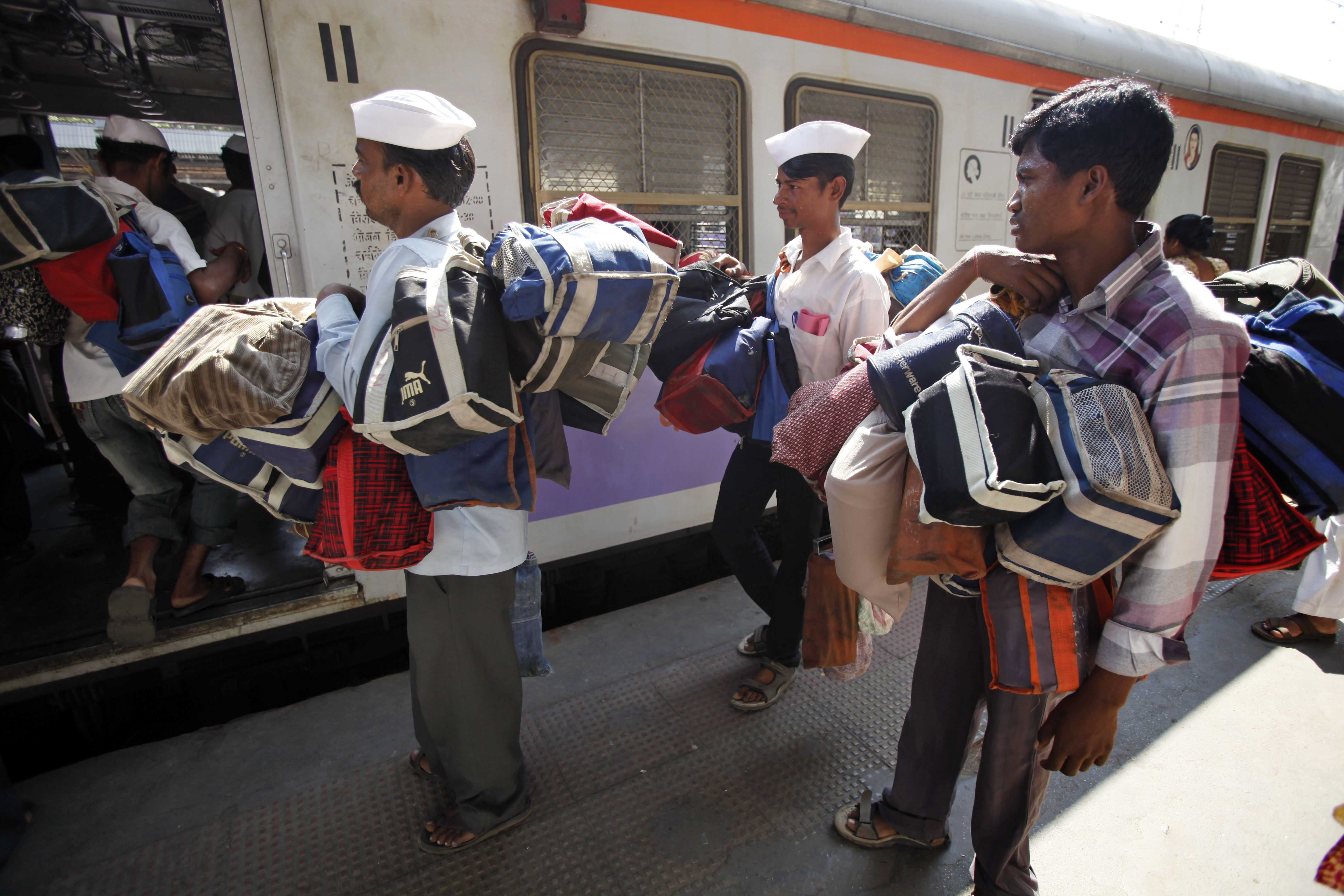 Dabbawalas boarding a train, part of their good business practices