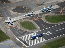 Airplanes on runways (AP Images)