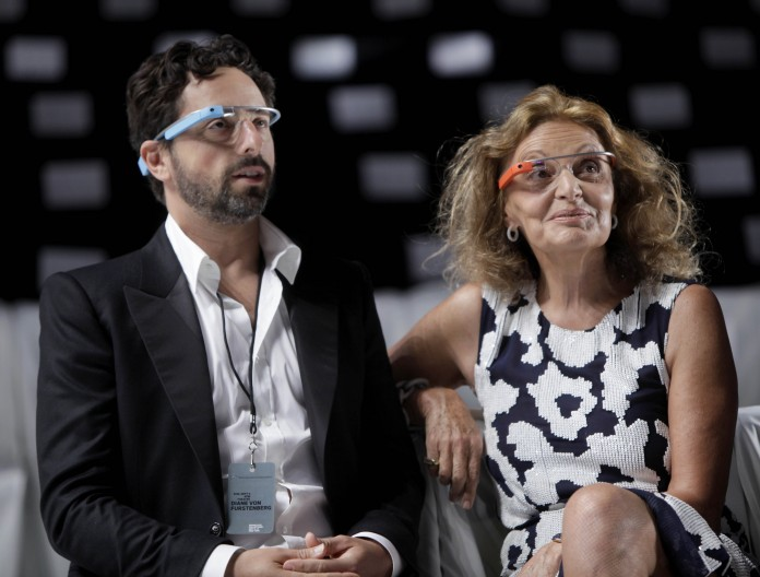 Sergey Brin and Diane von Fürstenberg, seated, in electronic headwear (AP Images)