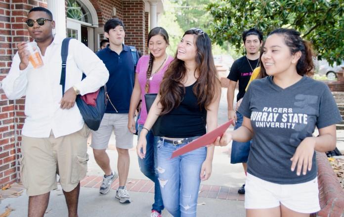 Group of international students walking (AP Images)