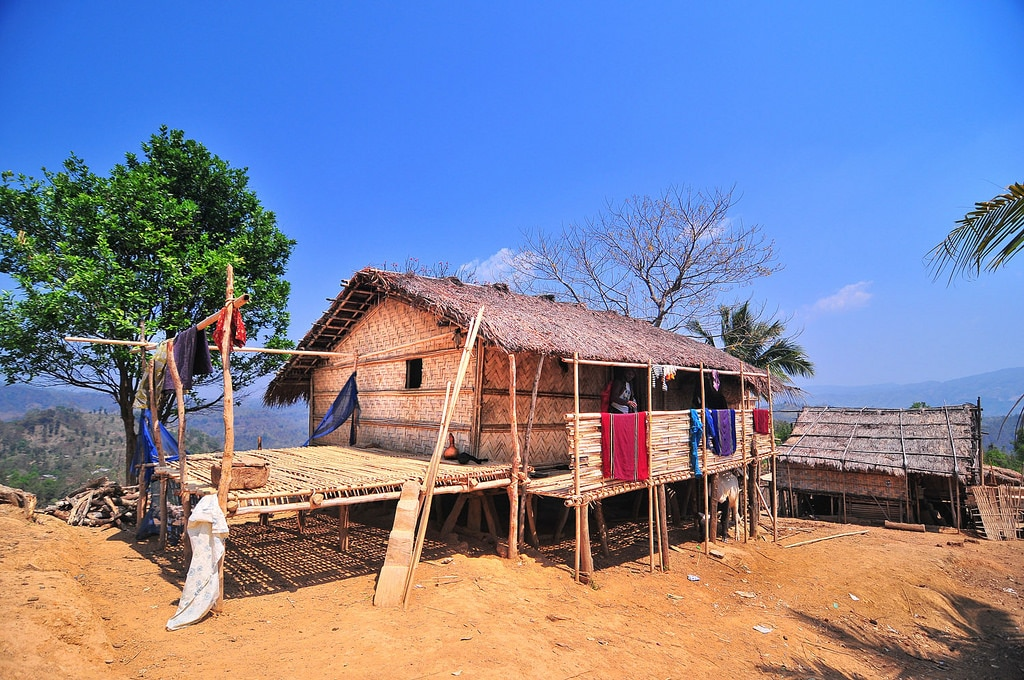 A house made of fibers sits on a hilltop.