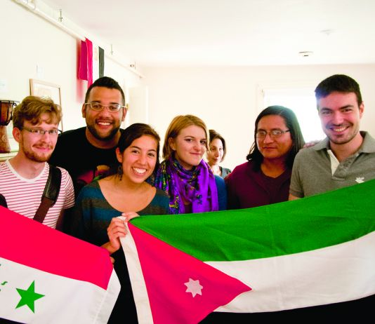 College students holding up two flags (Courtesy of Middlebury College)
