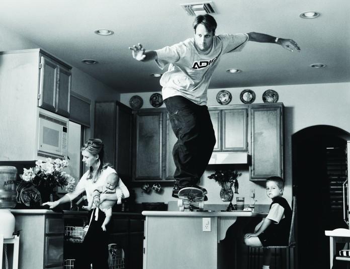 Tony Hawk skates off a kitchen counter.