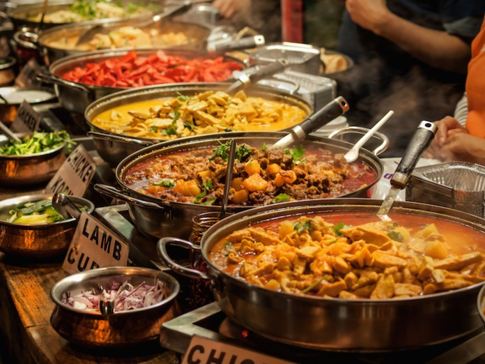 Indian food dishes on table (Shutterstock)