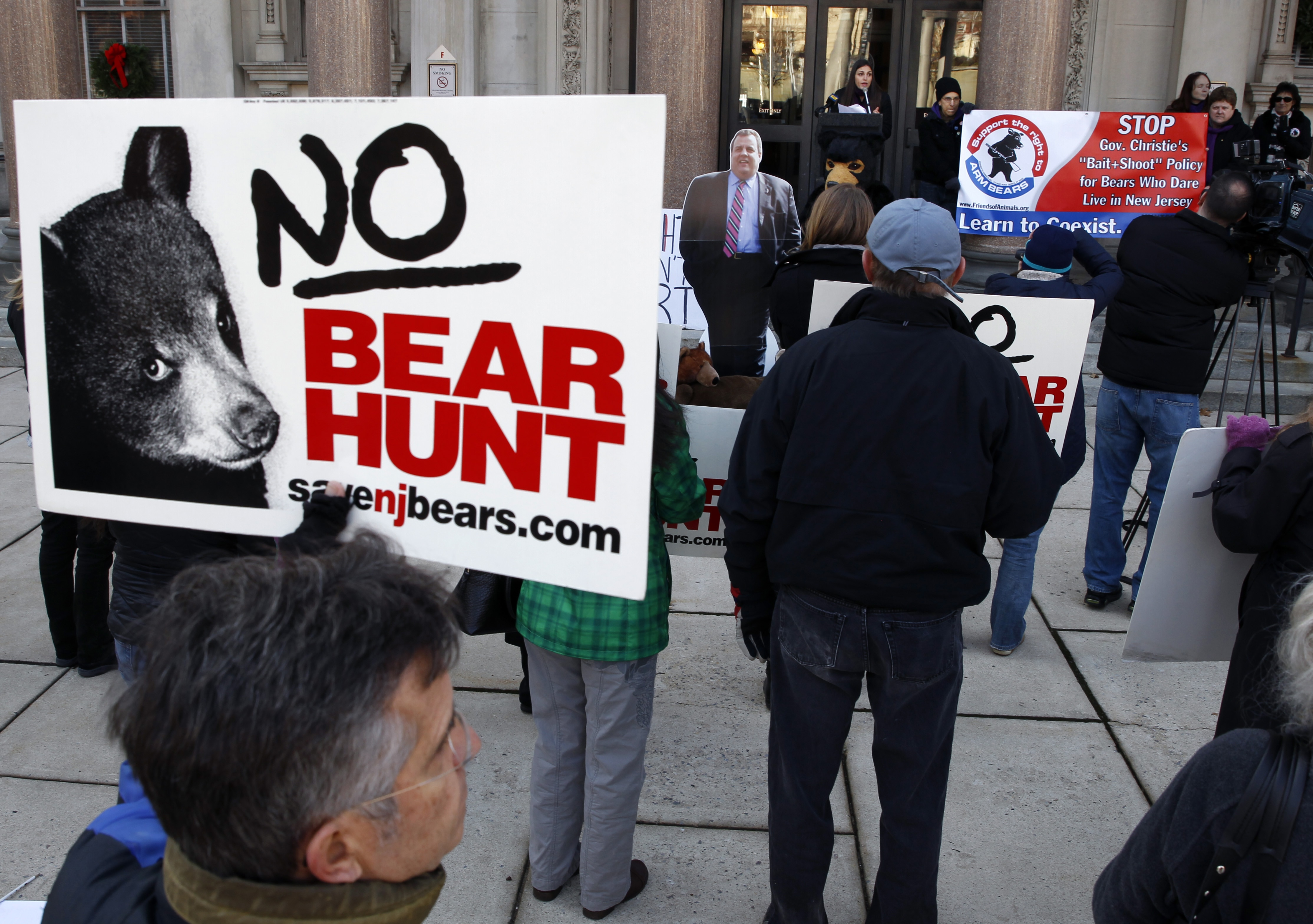 People gather to protest a bear hunt.