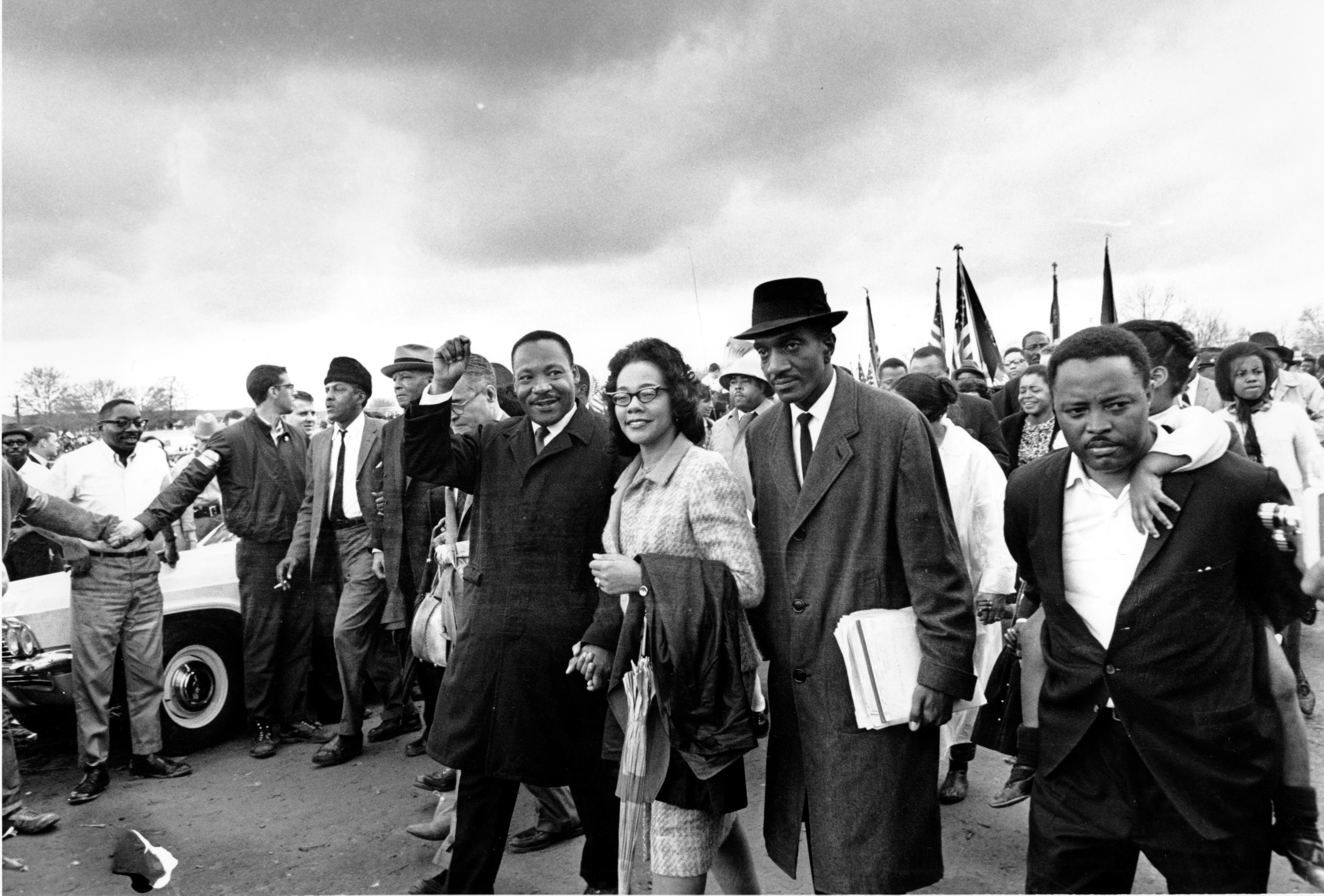 Martin Luther King and Coretta Scott King with group of people (© AP Images)