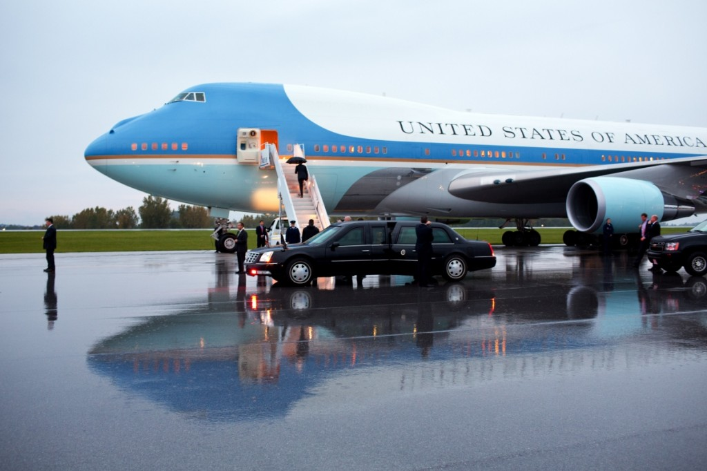 President Obama with umbrella climbing stairs to Air Force One (White House)