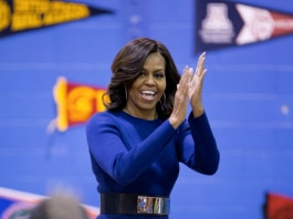 First lady Michelle Obama clapping (© AP Images)