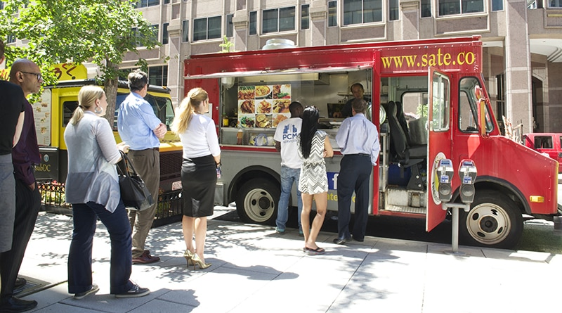 Line of people at a food truck.