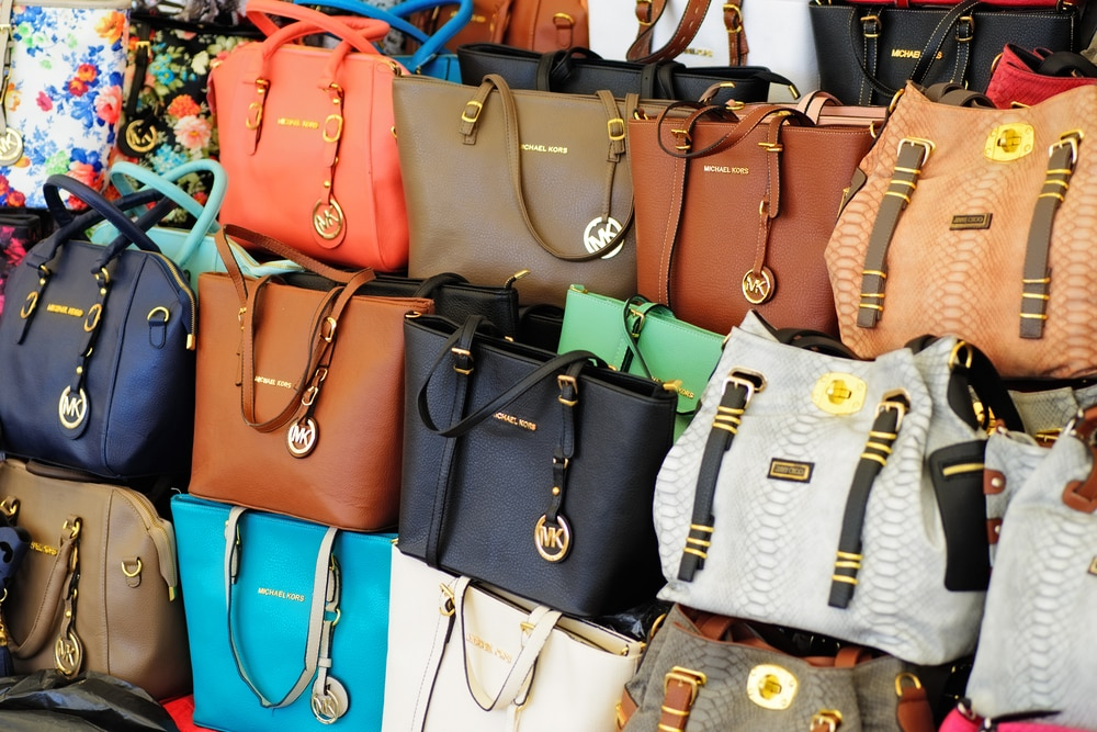 Handbags stacked at a market (Ian Law/Shutterstock)