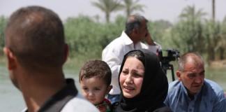 Un groupe d'Irakiens déplacés (© AP Images)