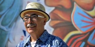 Juan Felipe Herrera in front of mural (Blue Flower Arts)