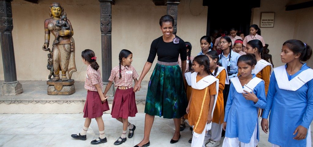 Michelle Obama with girls in school uniforms (White House)
