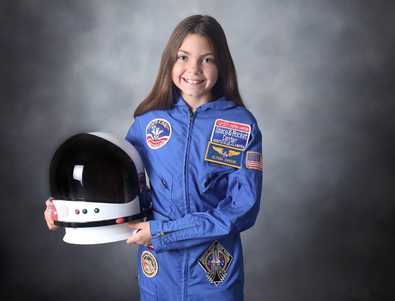 Smiling girl in astronaut suit (Facebook)