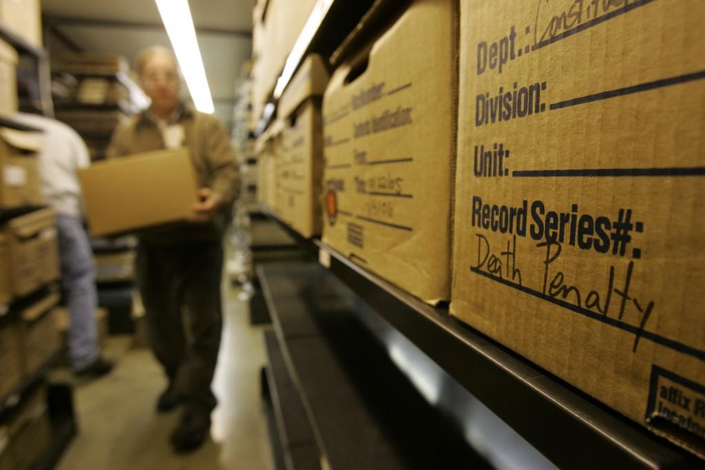 Room full of document boxes on shelves (© AP Images)