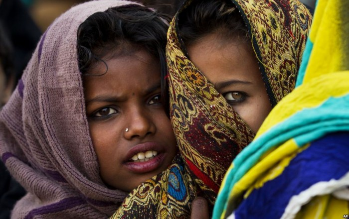 Two girls in headscarfs (© AP Images)