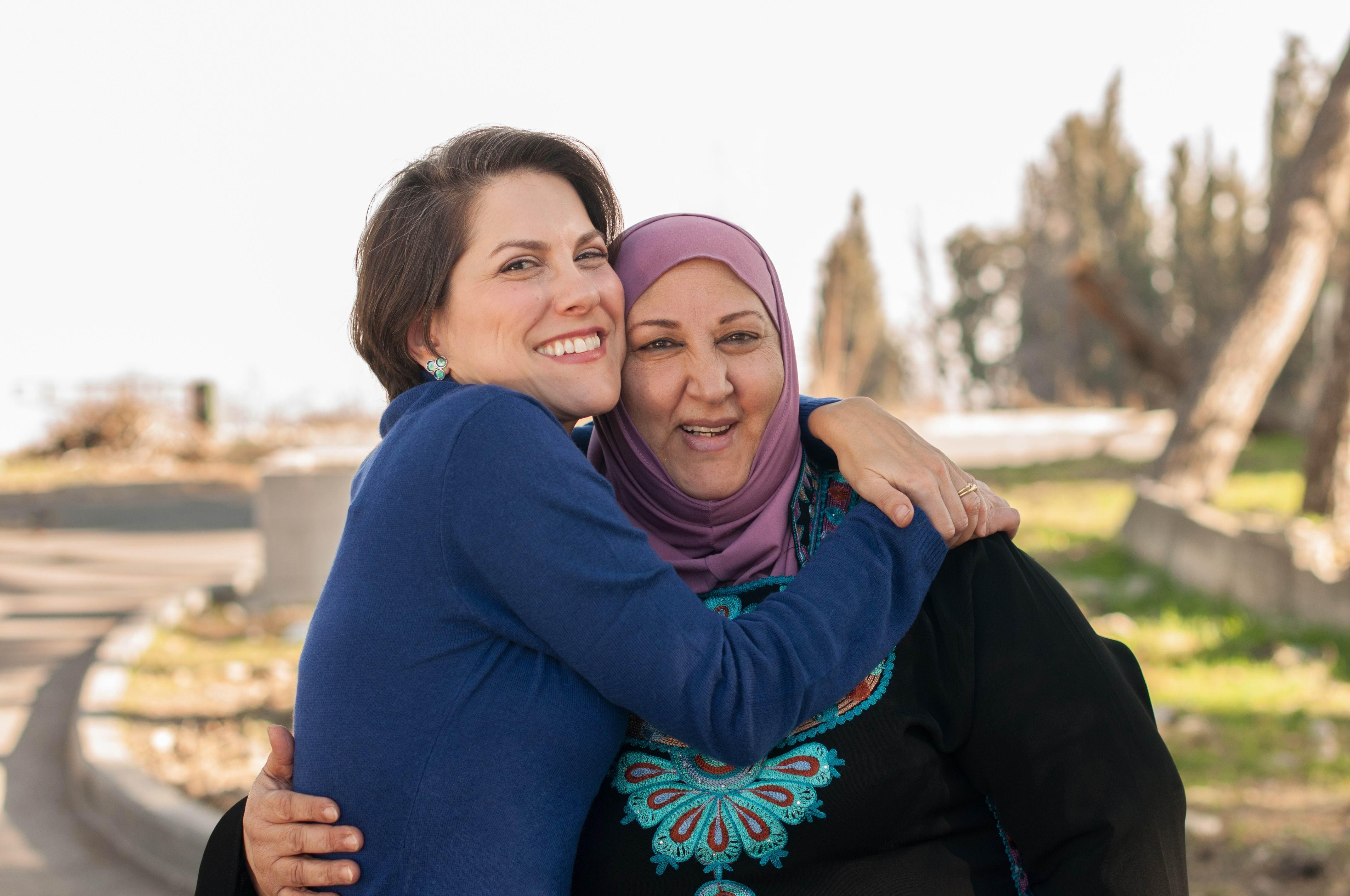 Ruth and Ibtisam hugging - photo credit Yitz Woolf
