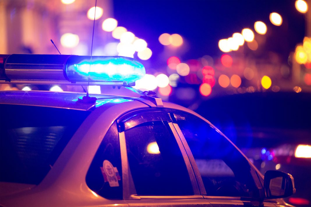 Police car with lights on (© Shutterstock)