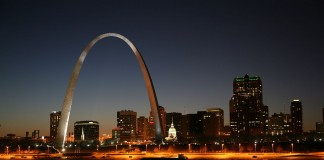 City at night with large arch on riverfront (Courtesy of Missouri Division of Tourism)