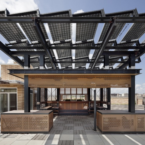 Modern-style house with awning made of solar panels (Courtesy of Richlite)