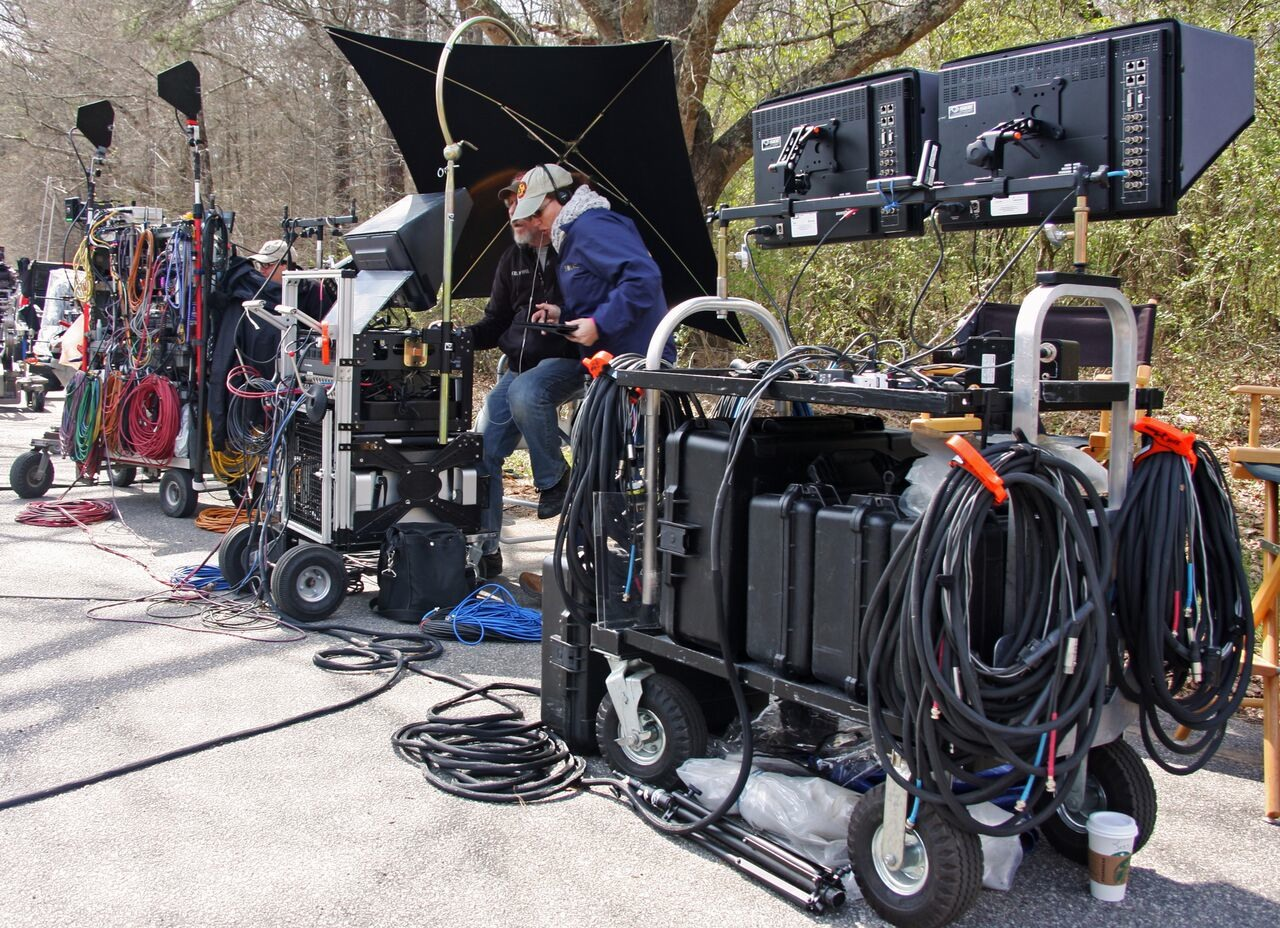 Filmmakers watching actors through a monitor on set (Courtesy of Georgia Department of Economic Development)