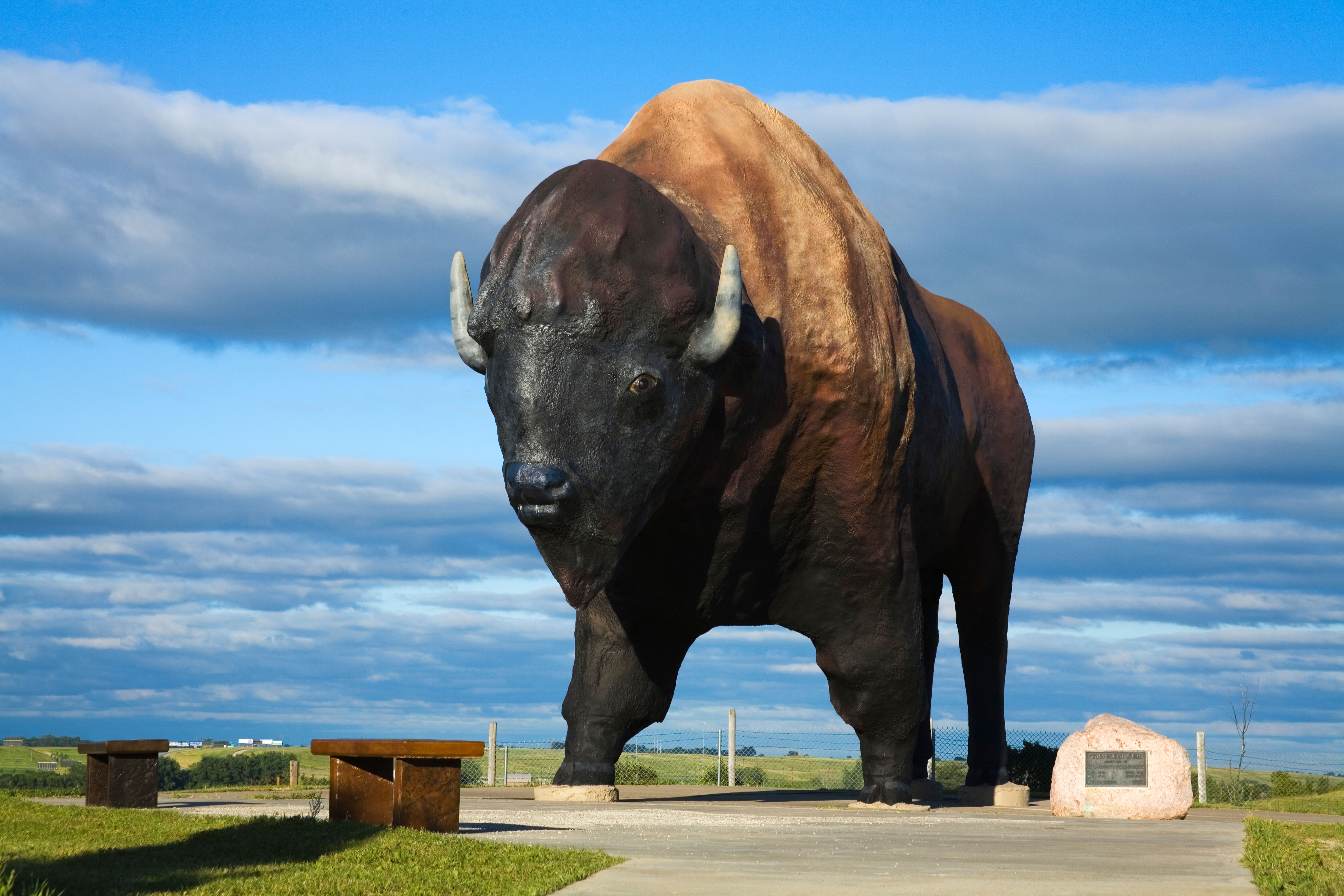 Huge statue of buffalo outdoors (© Richard Cummins/Alamy Stock Photo)
