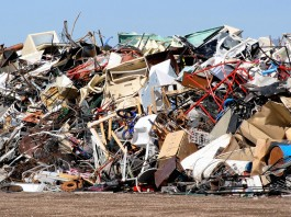 Pile of trash, discarded metal and furniture (© renemarie/Shutterstock)