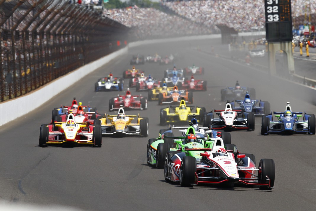 Cars racing at the Indianapolis Motor Speedway (Courtesy of Indianapolis Motor Speedway)