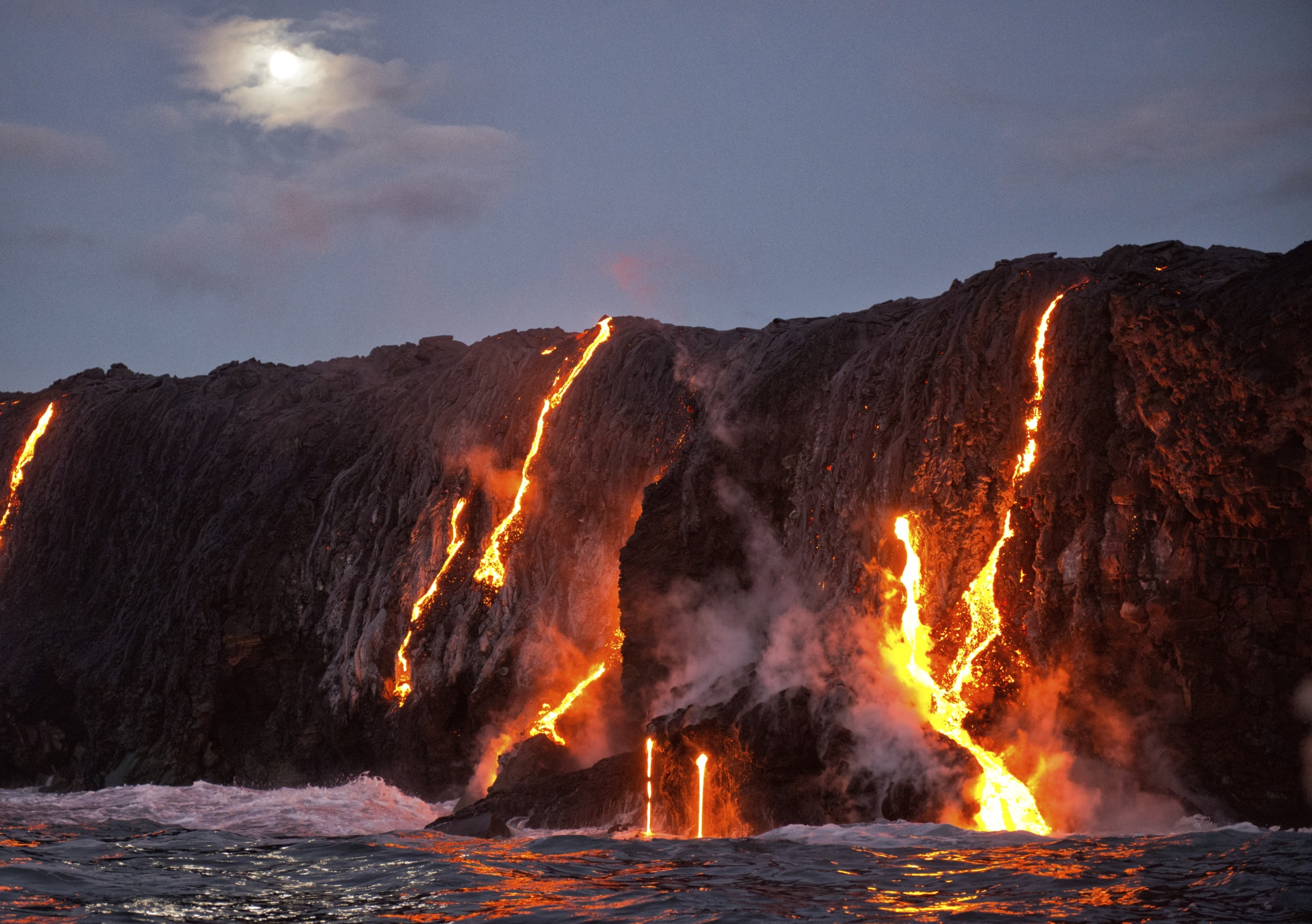 Lava flowing down volcano into water (ThinkStock)