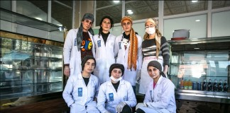 Women in white coats in front of bakery display cases (UNDP)