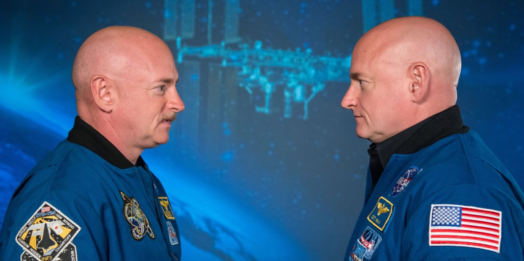 Twins in NASA flightsuits facing each other (NASA)