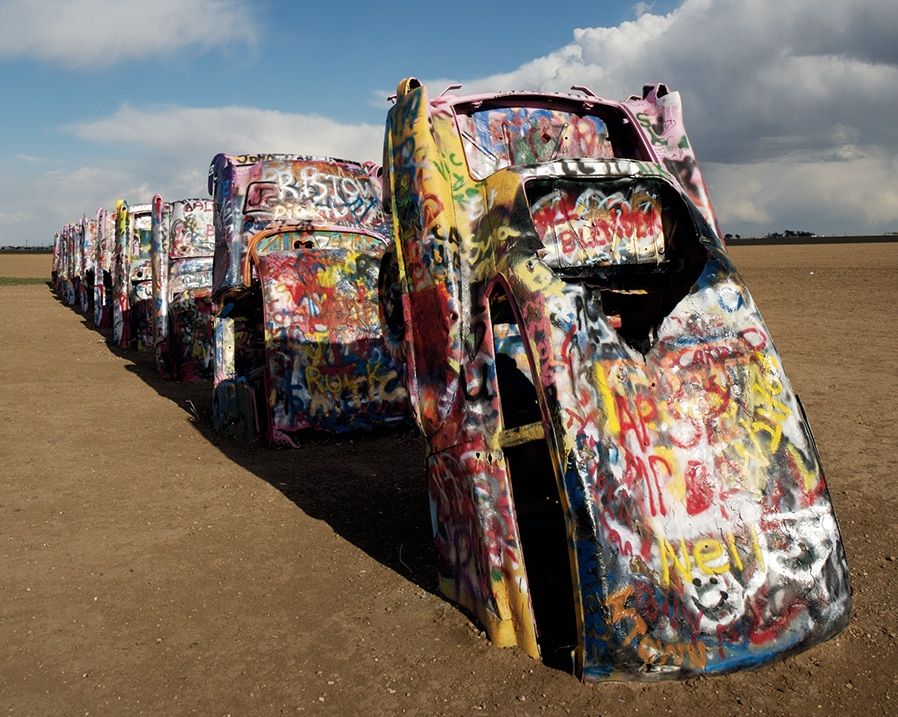 Row of colorfully painted Cadillacs partly underground (TexasTravel/Kenny Braun)