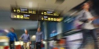 People walking quickly through an airport terminal (Shutterstock)