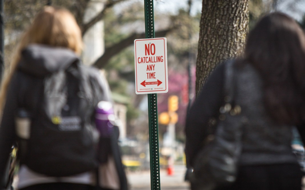 Street sign reading, 'No catcalling any time' (© AP Images)