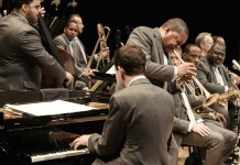 Men in gray suits playing instruments (Jazz at Lincoln Center/Frank Stewart)