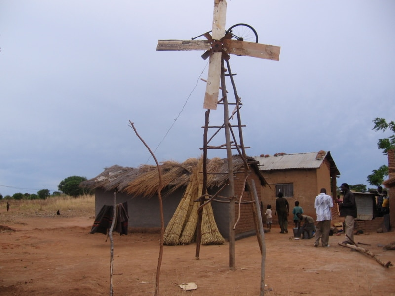 Building with windmill made of poles and sheets of metal (Courtesy of Erik (HASH) Hersman)